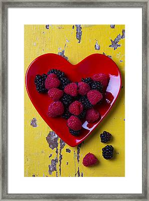 Red Heart Dish And Raspberries Framed Print by Garry Gay
