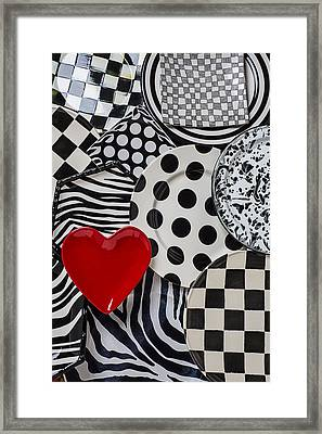 Red Heart Plate On Black And White Plates Framed Print by Garry Gay