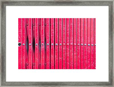 Red Metal Bars Framed Print by Tom Gowanlock