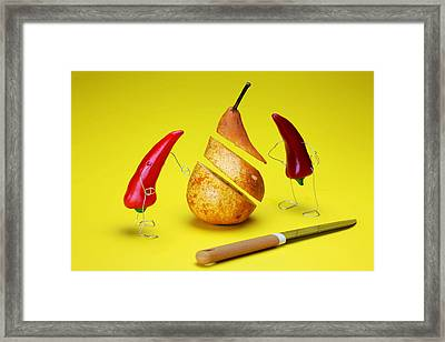 Red Peppers Sliced A Pear Framed Print by Paul Ge