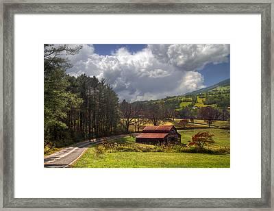 Red Roof Barn Framed Print by Debra and Dave Vanderlaan