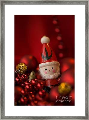 Red Santa Framed Print by Anne Gilbert