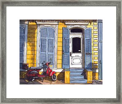 Red Scooter With Yellow House And Blue Shutters Framed Print by John Boles