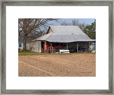 Red Tractor In A Tin Roofed Shed Framed Print by Paulette B Wright