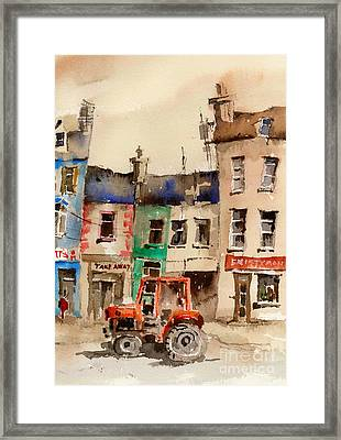 Red Tractor In Ennistymon Clare Framed Print by Val Byrne