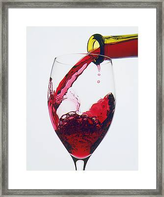 Red Wine Being Poured  Framed Print by Garry Gay