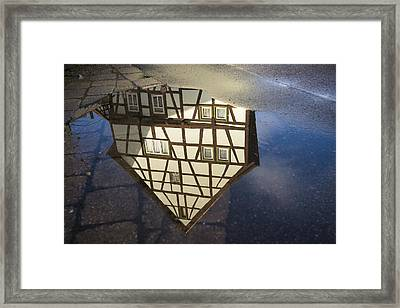 Reflection Of A Beautiful Old Half-timbered House In A Puddle Of Water Framed Print by Matthias Hauser