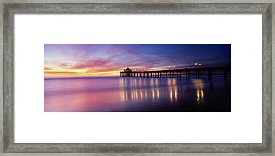 Reflection Of A Pier In Water Framed Print by Panoramic Images