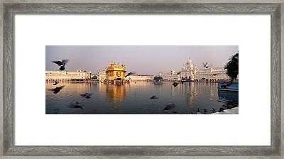 Reflection Of A Temple In A Lake Framed Print by Panoramic Images