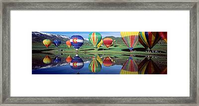 Reflection Of Hot Air Balloons On Framed Print by Panoramic Images