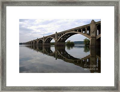 Reflections Of A Bridge Framed Print by Scott D Welch