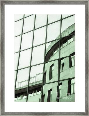 Reflections On The Building Framed Print by Odon Czintos