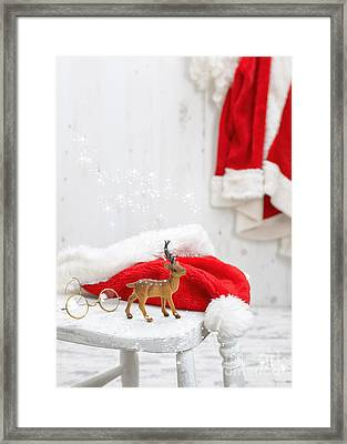 Reindeer With Santa Hat Framed Print by Amanda Elwell