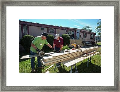 Repairing Storm Damage Framed Print by Jim West