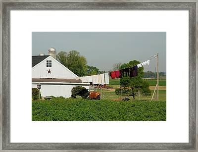 Red Star Washline Framed Print by Paul Yoder