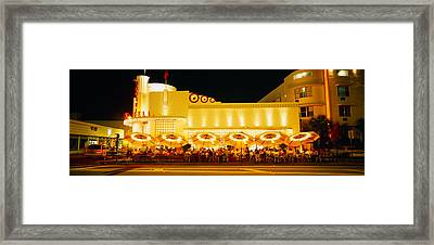 Restaurant Lit Up At Night, Miami Framed Print by Panoramic Images