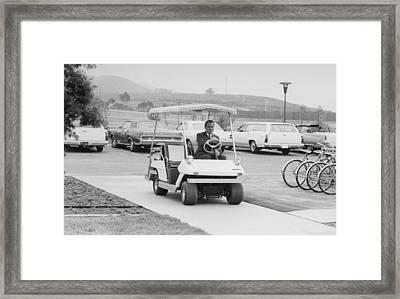 Richard Nixon Driving A Golf Cart Framed Print by Everett