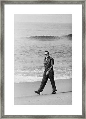 Richard Nixon Walking On The Beach Framed Print by Everett
