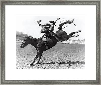 Riding A Bucking Bronco Framed Print by Underwood Archives