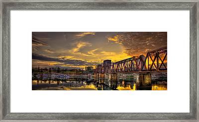 Riverwalk Marina Framed Print by Reid Callaway
