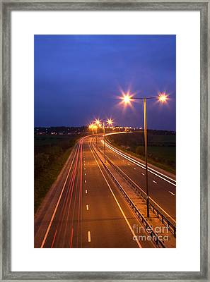 Road And Traffic At Night Framed Print by Colin and Linda McKie