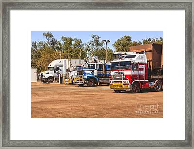 Road Trains Taking On Gas Or Diesel Framed Print by Colin and Linda McKie