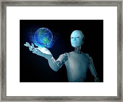 Robot Holding Earth Framed Print by Andrzej Wojcicki
