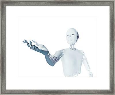 Robot With Arm Extended Framed Print by Andrzej Wojcicki
