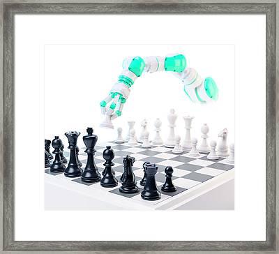 Robotic Arm Playing Chess Framed Print by Andrzej Wojcicki