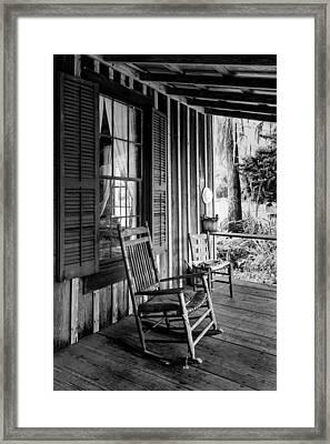 Rocker On The Veranda Framed Print by Lynn Palmer