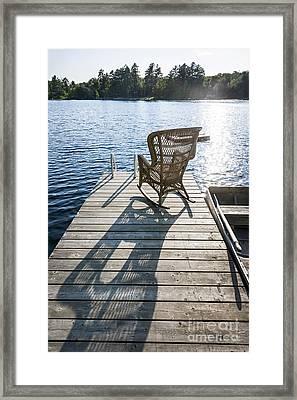 Rocking Chair On Dock Framed Print by Elena Elisseeva