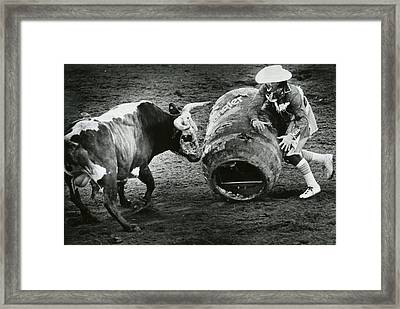 Rodeo Bull And Clown Fight Framed Print by Retro Images Archive