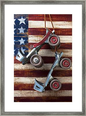 Rollar Skates With Wooden Flag Framed Print by Garry Gay