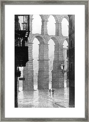 Roman Aqueduct In Segovia Spain Framed Print by German Hevia