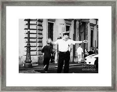 Roman Municipal Policeman Directs Traffic At A Pedestrian Crossing In The Via Teatro Marcello Rome Lazio Italy Framed Print by Joe Fox