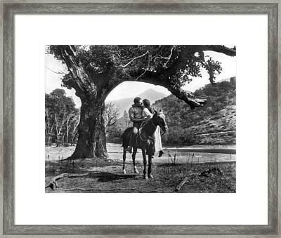 Romantic Kiss On Horseback Framed Print by Underwood Archives