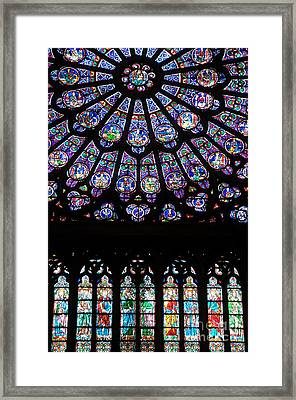 Rose Window . Famous Stained Glass Window Inside Notre Dame Cathedral. Paris Framed Print by Bernard Jaubert