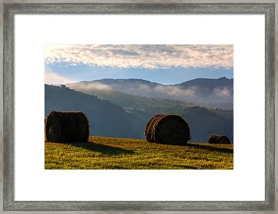 Round Bales And Foggy Hills Framed Print by John McArthur