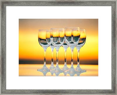 Row Of Wineglasses Against Golden Framed Print by Panoramic Images