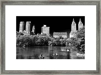 Rowing In Central Park Framed Print by John Rizzuto