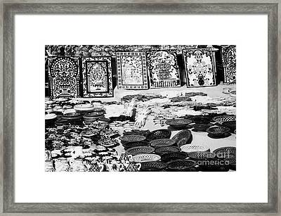 Rows Of Local Speciality Ceramics For Sale To Tourists On A Stall In The Souk Market In Nabeul Tunisia Framed Print by Joe Fox
