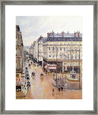 Rue Saint Honore Afternoon Rain Effect Framed Print by Camille Pissarro