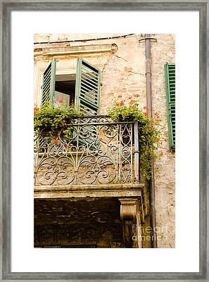 run down Italian balcony with shutters and flowers Framed Print by Peter Noyce
