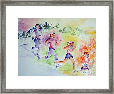 Running Toward The Marathon Framed Print by Sandy Ryan