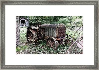 Rusted Mc Cormick-deering Tractor And Shed Framed Print by Michael Spano