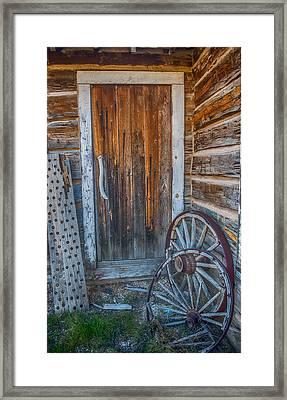 Rustic Door And Wagon Wheels Framed Print by Paul Freidlund