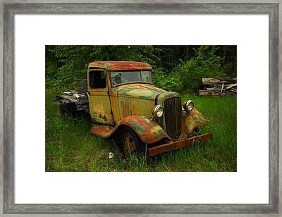 Rusting In The Weeds Framed Print by Jeff Swan