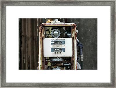 Rusting Petrol Pump Framed Print by Martin Bond