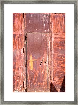 Rusty Doorway Framed Print by Tom Gowanlock