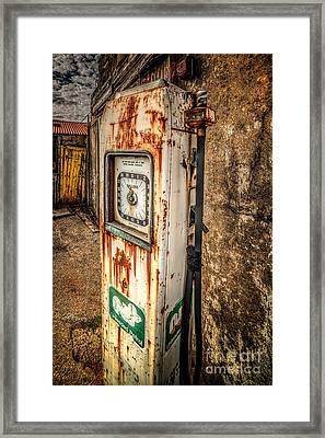 Rusty Gas Pump Framed Print by Adrian Evans
